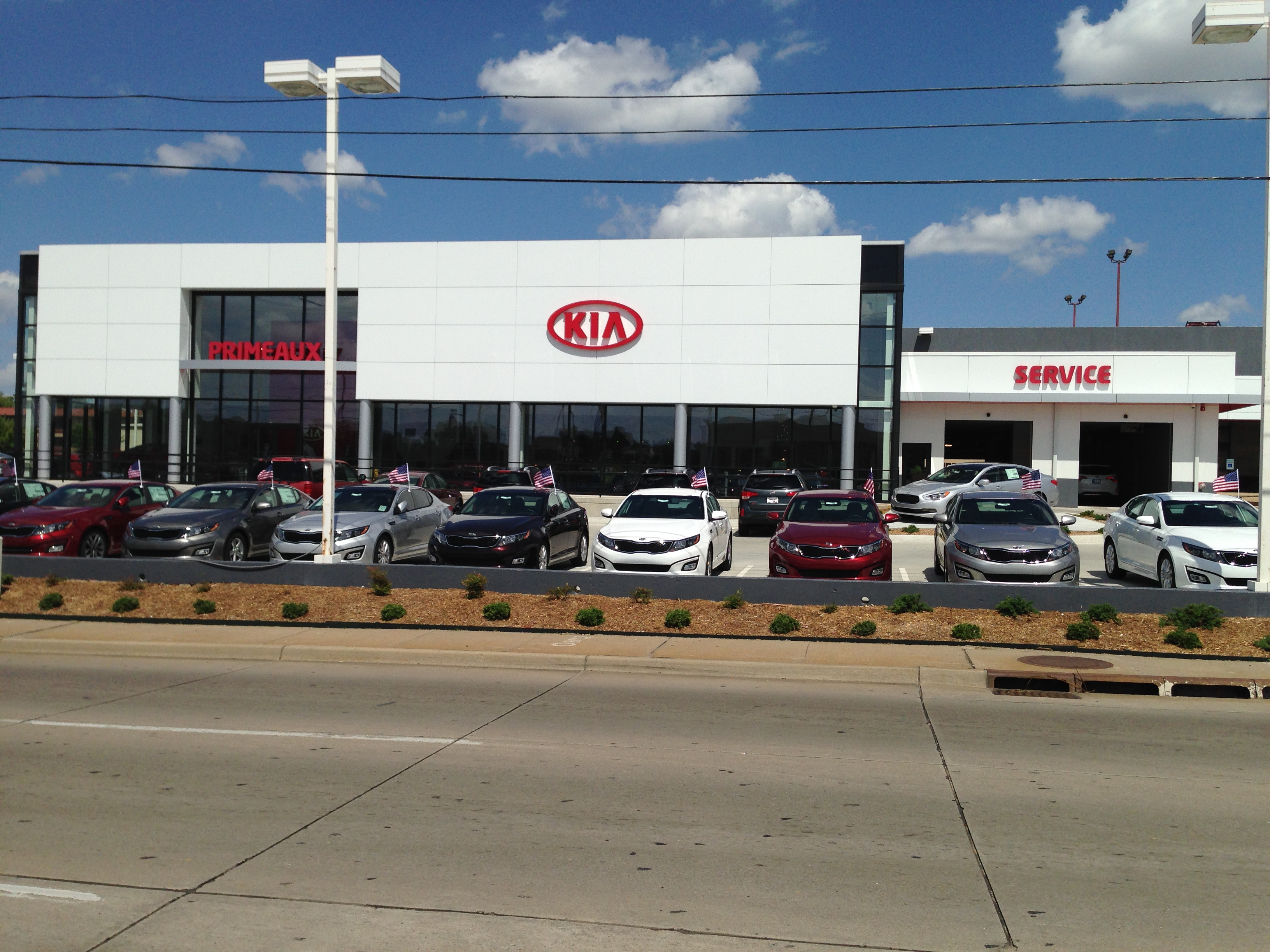 g money kia m phelan img cars in review dealerships drive car p room optima features adds first ga story new mark
